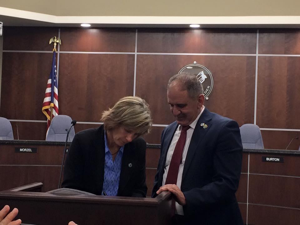 Mayors Jones and Sawalmeh signing sister city partnership agreement